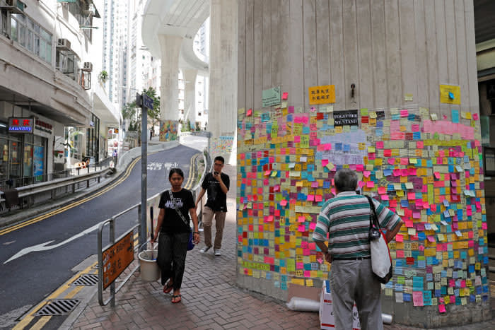 """Memos and notices are seen on """"Lennon Walls"""" by anti-extradition bill protesters at Sai Ying Pun in Hong Kong, China July 12, 2019. Picture taken July 12, 2019. REUTERS/Tyrone Siu - RC1EE8202970"""