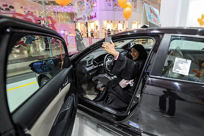 Saudi women tour a car showroom for women on January 11, 2018, in the Saudi Red Sea port city of Jeddah. / AFP PHOTO / Amer HILABI (Photo credit should read AMER HILABI/AFP/Getty Images)
