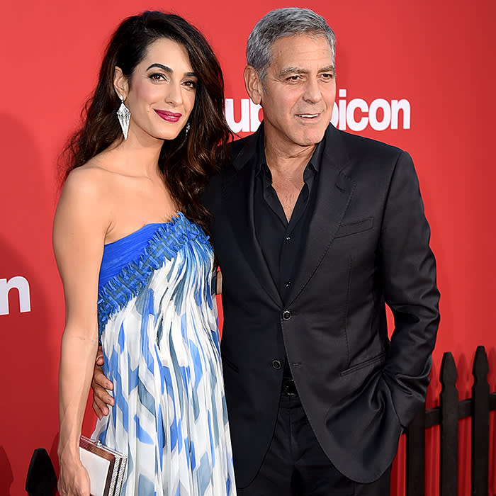 """LOS ANGELES, CA - OCTOBER 22: Executive producer George Clooney (R) and his wife Amal Clooney arrive at the premiere of Paramount Pictures' """"Suburbicon"""" at the Village Theatre on October 22, 2017 in Los Angeles, California. (Photo by Kevin Winter/Getty Images)"""