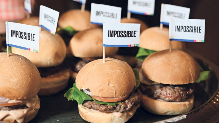 "The Impossible Burger 2.0, the new and improved version of the company's plant-based vegan burger that tastes like real beef is introduced at a press event during CES 2019 in Las Vegas, Nevada on January 7, 2019. - The updated version can be cooked on a grill and has a better flavor and lowered cholesterol, fat and calories than the original. ""Unlike the cow, we get better at making meat every single day,"" CEO of Impossible Foods CEO Pat Brown. (Photo by Robyn Beck / AFP) (Photo credit should read ROBYN BECK/AFP/Getty Images)"
