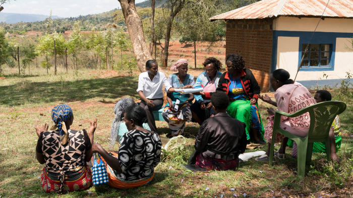 A women's group discusses and pays back loans under the guidance of a Kenya Women Microfinance Bank (KWFT) officer during a meeting in Kyangala, Kenya, November 15, 2018.