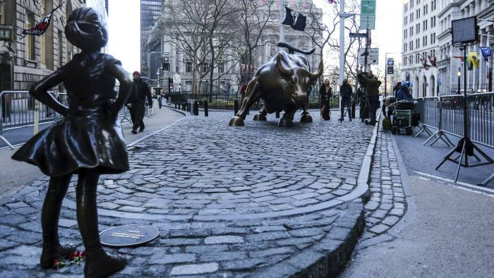 NEW YORK, NY - MARCH 9: Hundreds of tourists take photos of 'The Fearless Girl' statue as it stands across from the Wall Street's famous Charging Bull to draw attention to the gender equality and lack of female managers on March 09, 2017 in New York City, US. Third largest asset manager worldwide State Street Global Advisors installed the statue on March 08, 2017. (Photo by William Volcov/Brazil Photo Press/LatinContent/Getty Images)
