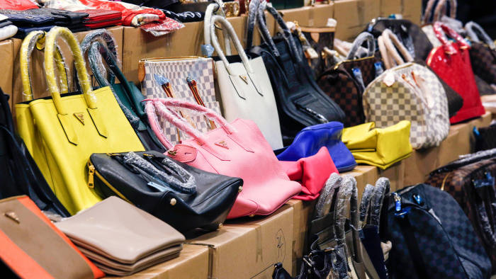 Counterfeit handbags are displayed by Customs and Excise Department during a news conference in Hong Kong September 19, 2014. The customs and the police in the territory have conducted a joint operation to combat the selling of counterfeit products at two storehouses, seizing 2,360 counterfeit goods valued at over HK$1 million (approx. $128,000). Two men were arrested in the operation, according to the official press release from the customs. REUTERS/Bobby Yip (CHINA - Tags: CRIME LAW BUSINESS) - GM1EA9J1CGL01