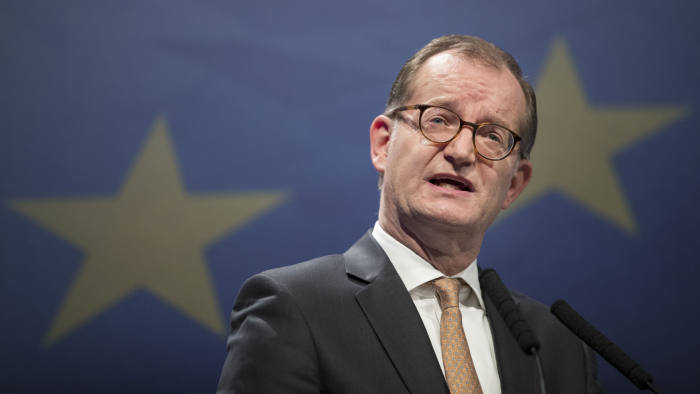 """Martin Zielke, chief executive officer of Commerzbank AG, speaks during Euro Finance Week in Frankfurt, Germany, on Friday, Nov. 18, 2016. European Central Bank (ECB) President Draghi said the recovery in the 19-nation euro area isn't yet strong enough to deliver sustained reflation, and the current level of monetary support will be a """"key ingredient"""" for the economic outlook in the coming years. Photographer: Jasper Juinen/Bloomberg"""