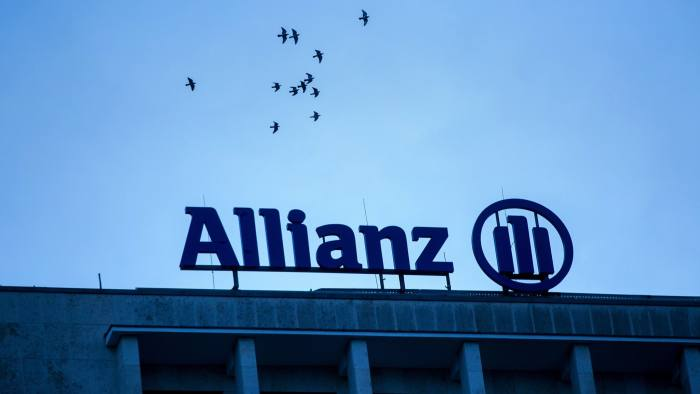 The Allianz SE logo sits on a top of a building in Berlin, Germany, on Wednesday, Jan. 4, 2017. Germany had another year of firm growth in 2016 and should continue to be propelled in 2017 by consumer spending. Photographer: Krisztian Bocsi/Bloomberg