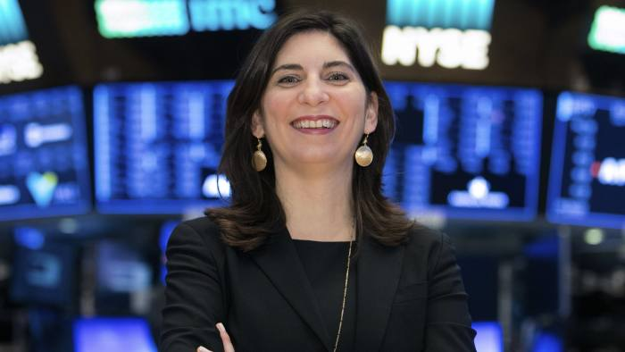 In this undated photo provided by the New York Stock Exchange, Stacey Cunningham poses for a photo at the Stock Exchange in New York. Cunningham, the chief operating officer for the NYSE group, will become the 67th president of the Big Board. (Alyssa Ringler/NYSE via AP)