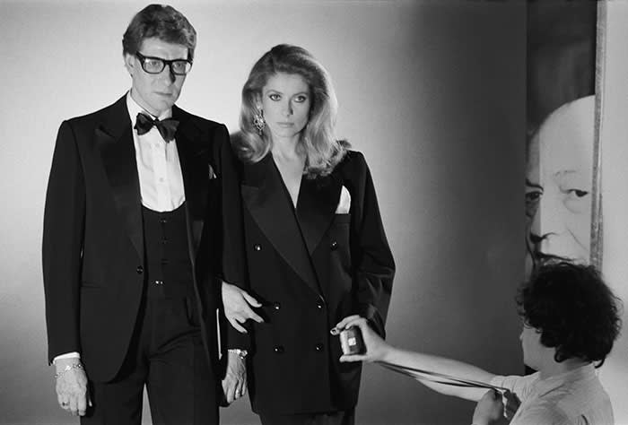 a1a520f5b14 Catherine Deneuve and Yves Saint Laurent at a Helmut Newton shoot in 1981 ©  Getty
