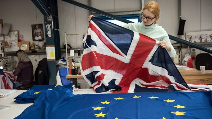 A flag manufacturer folds finished Union Flags and EU flags at the factory of 'Flagmakers' in Chesterfield, northern England on March 24, 2017. The British government has announced its intention to trigger the Article 50 clause to begin the UK's withdrawl from the European Union (EU) on March 29. / AFP PHOTO / Oli SCARFF (Photo credit should read OLI SCARFF/AFP/Getty Images)