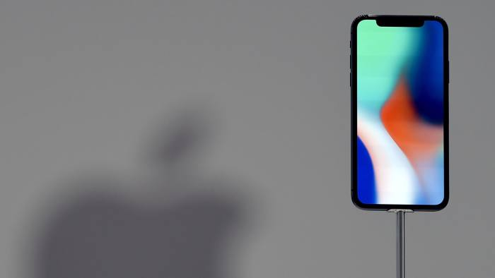 (FILES) This file photo taken on September 12, 2017 shows an iPhone X during a media event at Apple's new headquarters in Cupertino, California.  		Apple announced on January 17, 2018, it would pay about $38 billion in taxes -- likely the largest payment of its kind -- on profits repatriated from overseas as it boosts investments in the United States. / AFP PHOTO / Josh EdelsonJOSH EDELSON/AFP/Getty Images