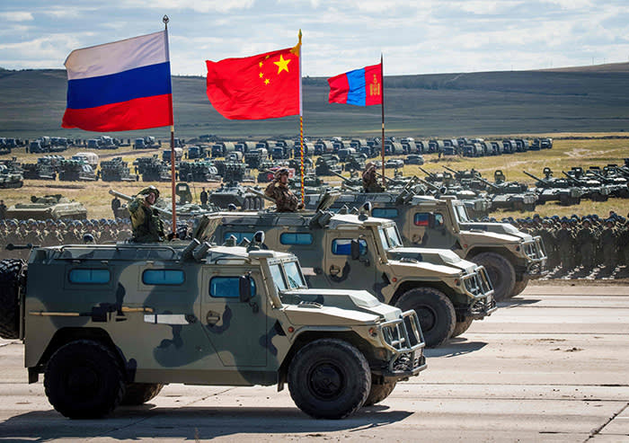 Russian, Chinese and Mongolian troops and military equipment parade at the end of the day of the Vostok-2018 (East-2018) military drills at Tsugol training ground not far from the Chinese and Mongolian border in Siberia, on September 13, 2018. (Photo by MLADEN ANTONOV / AFP)MLADEN ANTONOV/AFP/Getty Images