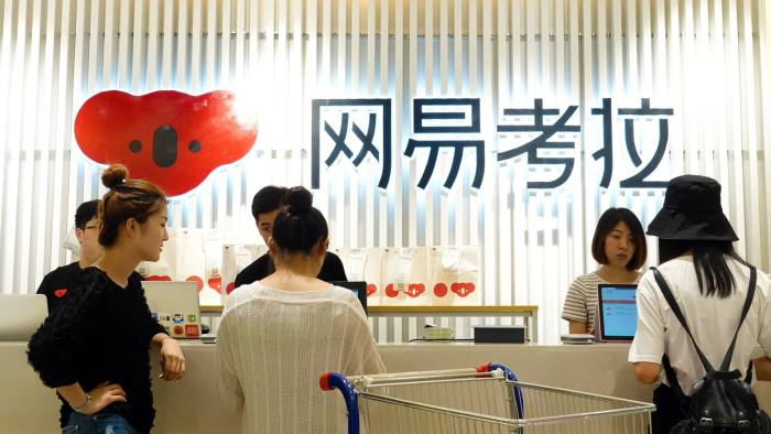 People are seen at the check-out counter of a physical store of Netease's e-commerce platform Kaola, in Zhengzhou, Henan province, China August 11, 2018. Picture taken August 11, 2018.REUTERS/Stringer ATTENTION EDITORS - THIS IMAGE WAS PROVIDED BY A THIRD PARTY. CHINA OUT.