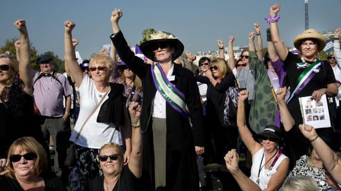 Women born in the 1950s held a Day of Action to draw attention to the women affected by the rise of the state pension age, from 60 to 66, organised by different groups including WASPI (Women Against State Pension Inequality Campaign), BackTo60, and We Paid In You Pay Out on October 10th 2018 in London, United Kingdom. A group, mainly women, raise their fists. (photo by Jenny Matthews/In Pictures via Getty Images)