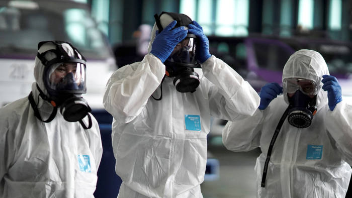 FILE PHOTO: Members of the Thai Airways crew prepare themselves before disinfecting the cabin of an aircraft of the national carrier during a procedure to prevent the spread of the coronavirus at Bangkok's Suvarnabhumi International Airport, Thailand, January 28. REUTERS/Athit Perawongmetha/File Photo