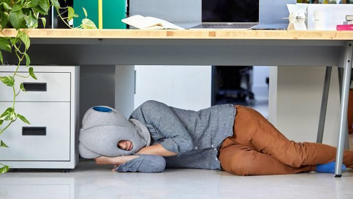 Japan office naps - Ostrich Pillow https://eu.ostrichpillow.com/products/ostrichpillow-original