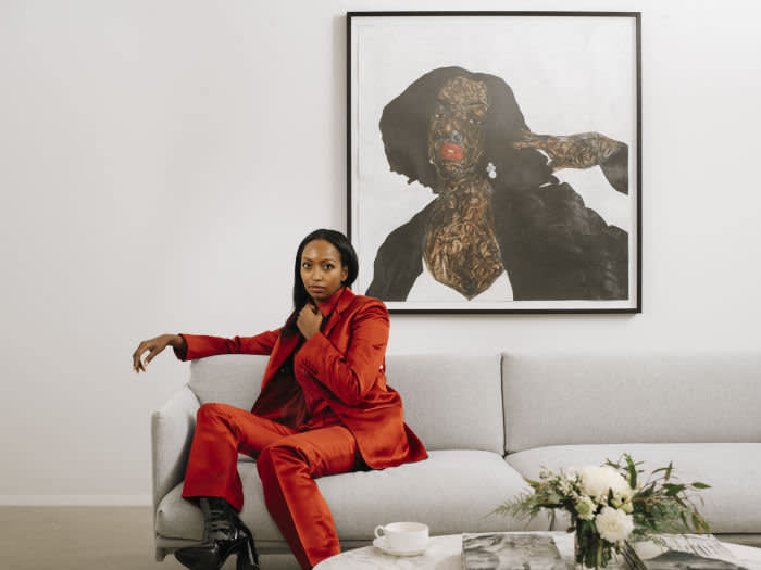 Mariane Ibrahim photographed for The FT by Dave Kasnic, at her gallery in Chicago. Artwork behind her: Amoako Boafo, Follow Monica, 2019