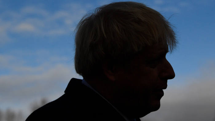 Britain's Prime Minister Boris Johnson speaks to the media at the soccer match venue, during his campaign event in Cheadle Hulme, Britain December 7, 2019. REUTERS/Toby Melville/Pool