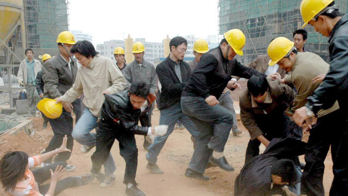 epa00603927 A fight broke out between 50 to 60 rural migrant workers and management staff of the construction company when the migrant workers turned off the electricity switch after they failed to collect their unpaid wages at the construction site in Haikou, south China's Hainan province, Wednesday 28 December 2005. Five from both sides were badly injured in the battle. Migrant workers always seek to recover their unpaid wages during the period immediately before the Spring festival. Most of them rely heavily on their earnings to spend during the festival. EPA/STR