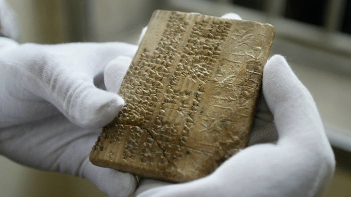 TO GO WITH ARABIC STORY IRAN-US-ARCHAEOLOGY: An Archaemenian clay tablet, in the Elamite scripts, which were written in cuneiform writing, is shown at Iran's National Museum in Tehran, 01 May 2004. An American delegation returned to Iran's National Museum a set of 300 ancient tablets held by the University of Chicago's Oriental Institute on loan to them since 1937. The tablets record the workings of the Persian administration -- including details such as the daily food rations given to workers -- but perhaps more importantly they provide one of the few Persian sources of information on the Persian Empire. Much of what is known about the empire -- which sprawled from Ethiopia to Egypt, Greece, modern-day Turkey, Central Asia and India -- has been gathered from Greek and Latin texts, according to the experts at the Oriental Institute. These tablets record the administrative details of the Persian Empire from about 500 BC. AFP PHOTO/Behrouz MEHRI (Photo credit should read BEHROUZ MEHRI/AFP via Getty Images)