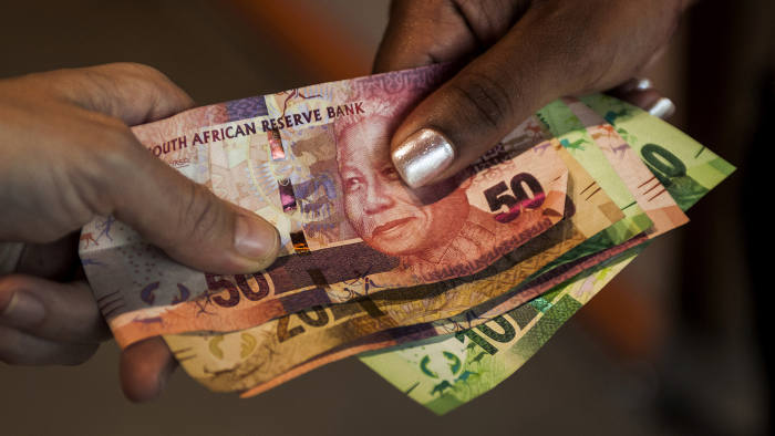 South African rand banknotes sit in this arranged photograph in Pretoria, South Africa, on Monday, Dec. 14, 2015. South Africa's government was left trying to shore up credibility after President Jacob Zuma's debacle over who should run the finance ministry called into question his ability to oversee the economy. Photographer: Waldo Swiegers/Bloomberg