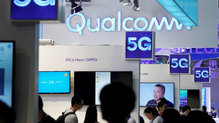 FILE PHOTO: Signs of Qualcomm and 5G are pictured at Mobile World Congress (MWC) in Shanghai, China June 28, 2019. REUTERS/Aly Song/File Photo