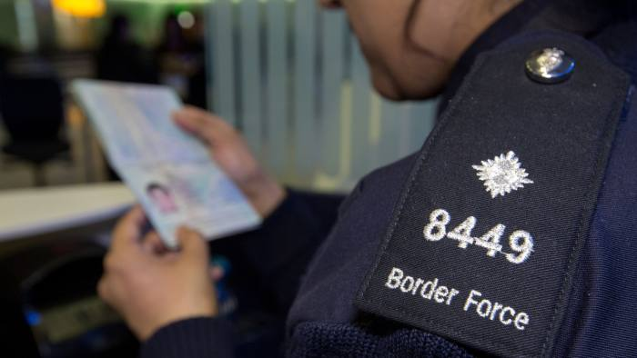 Embargoed to 0001 Wednesday October 25 File photo dated 04/06/14 of a Border Force officer checking passports, as a report by Migration Watch UK, movement between the UK and the EU should remain