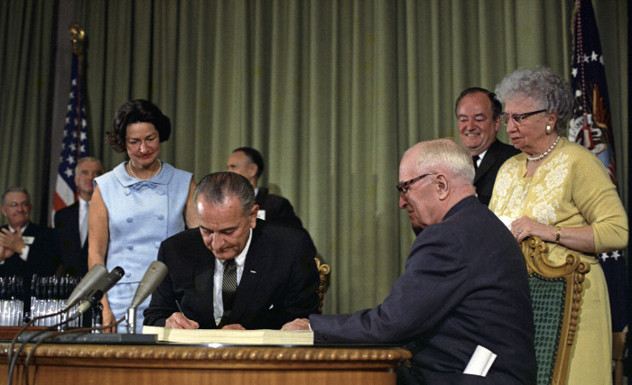 President Lyndon Johnson signing Medicare Bill, Independence, Missouri, Harry Truman looks on, 30 Jul 1965. (Photo by: Universal History Archive/Universal Images Group via Getty Images)