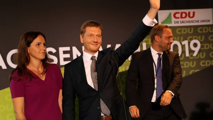 DRESDEN, GERMANY - SEPTEMBER 01: Michael Kretschmer, Governor of Saxony and member of the German Christian Democrats (CDU), waves as he reacts to initial exit poll results in the Saxony state elections at the Saxony State Parliament on September 1, 2019 in Dresden, Germany. Saxony and the neighboring state of Brandenburg, both states in eastern Germany, are holding state election amidst a strong growth in support in pre-election polls for the right-wing Alternative for Germany (AfD) and the Greens Party at the expense of the German Christian Democrats (CDU) and the German Social Democrats (SPD). (Photo by Maja Hitij/Getty Images) *** BESTPIX ***