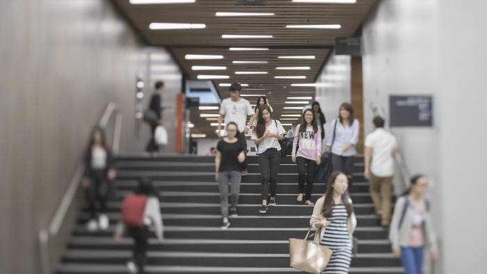Students on the stairs in the Abercrombie Building - University of Sydney Business School . press image