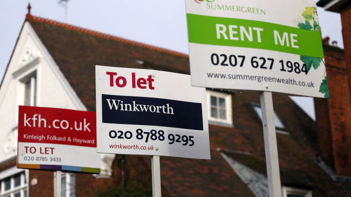 "Estate agent signs advertising properties ""To Let"" and ''Rent Me"" stand outside residential buildings in the Roehampton district of London, U.K., on Friday, Nov. 23, 2012. U.K. mortgage approvals rose to a nine-month high in October, the British Bankers' Association said. Photographer: Simon Dawson/Bloomberg"
