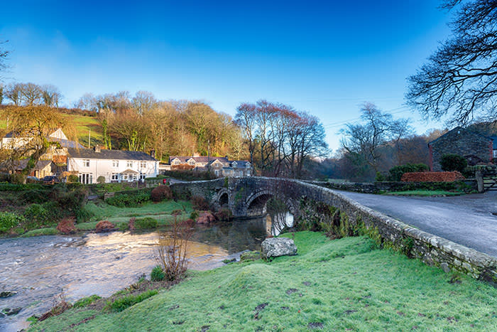 EEX8B9 The River Walkham flowing under the old granite bridge at the picturesque village of Little Huckworthy on Dartmoor National park