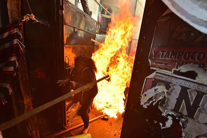 TOPSHOT - Mexican riot police clash with residents of an indigenous camp as they are evicted from the improvised homes where many had been living for years in Mexico city on September 19, 2018. (Photo by Pedro Pardo / AFP)PEDRO PARDO/AFP/Getty Images