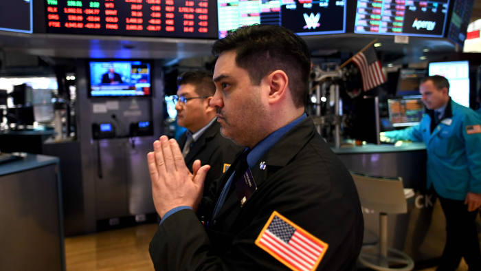 Traders work during the opening bell at the New York Stock Exchange (NYSE) on March 16, 2020 at Wall Street in New York City. - Trading on Wall Street was halted immediately after the opening bell Monday, as stocks posted steep losses following emergency moves by the Federal Reserve to try to avert a recession due to the coronavirus pandemic.Just after the opening bell, the S&P 500 was at 2,490.47, a drop of 8.1 percent and beyond the seven percent loss that automatically triggers a 15-minute trading halt. (Photo by Johannes EISELE / AFP) (Photo by JOHANNES EISELE/AFP via Getty Images)