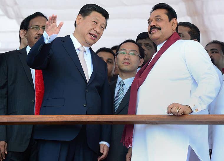 Xi Jinping, China's president, and former Sri Lankan leader Mahinda Rajapaksa image