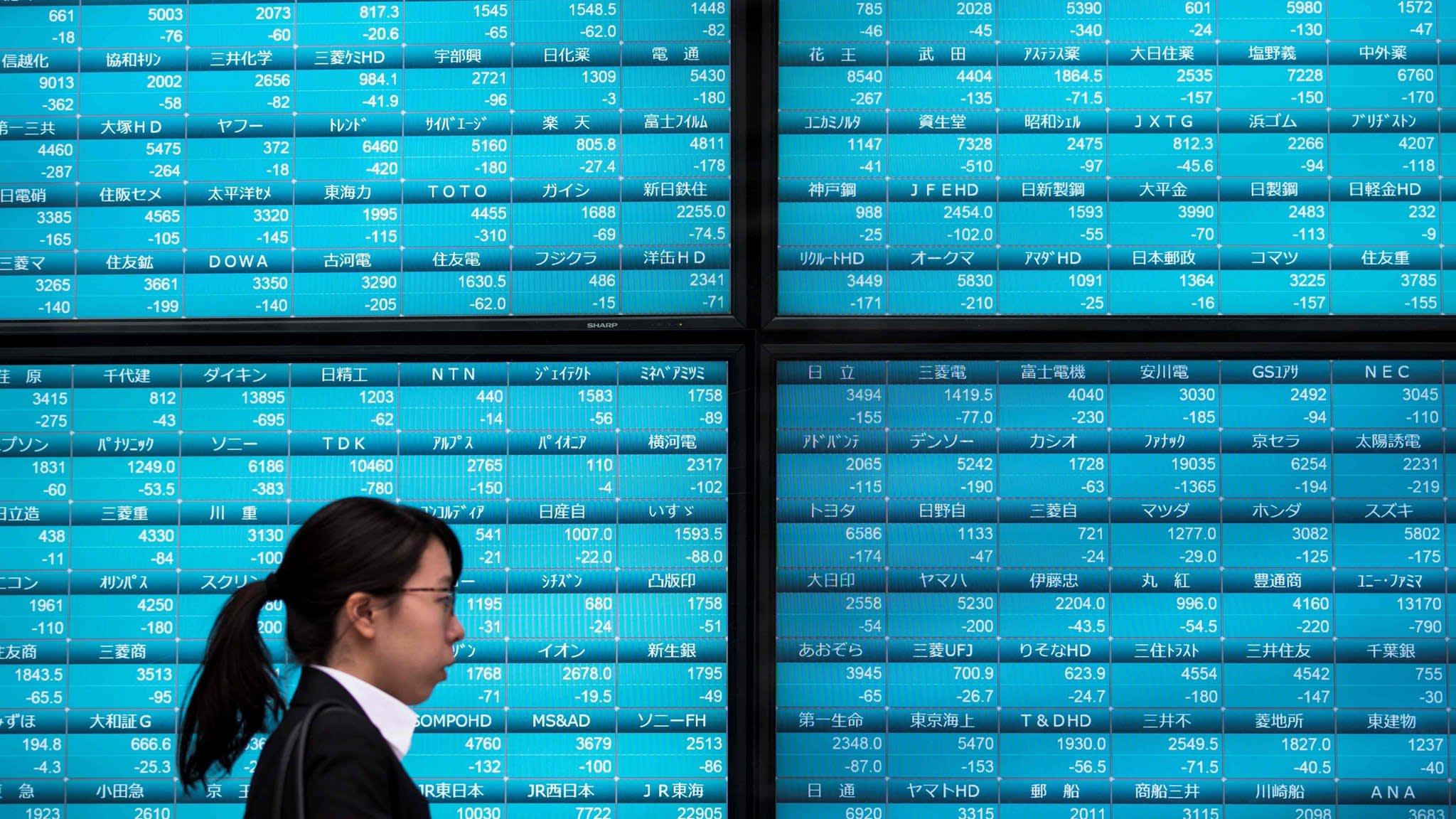 Asia shares fall as Wall Street rebound fails to gain traction