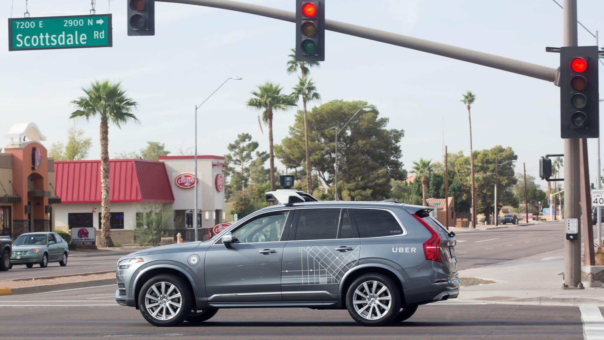 Uber halts self-driving car tests after fatal collision