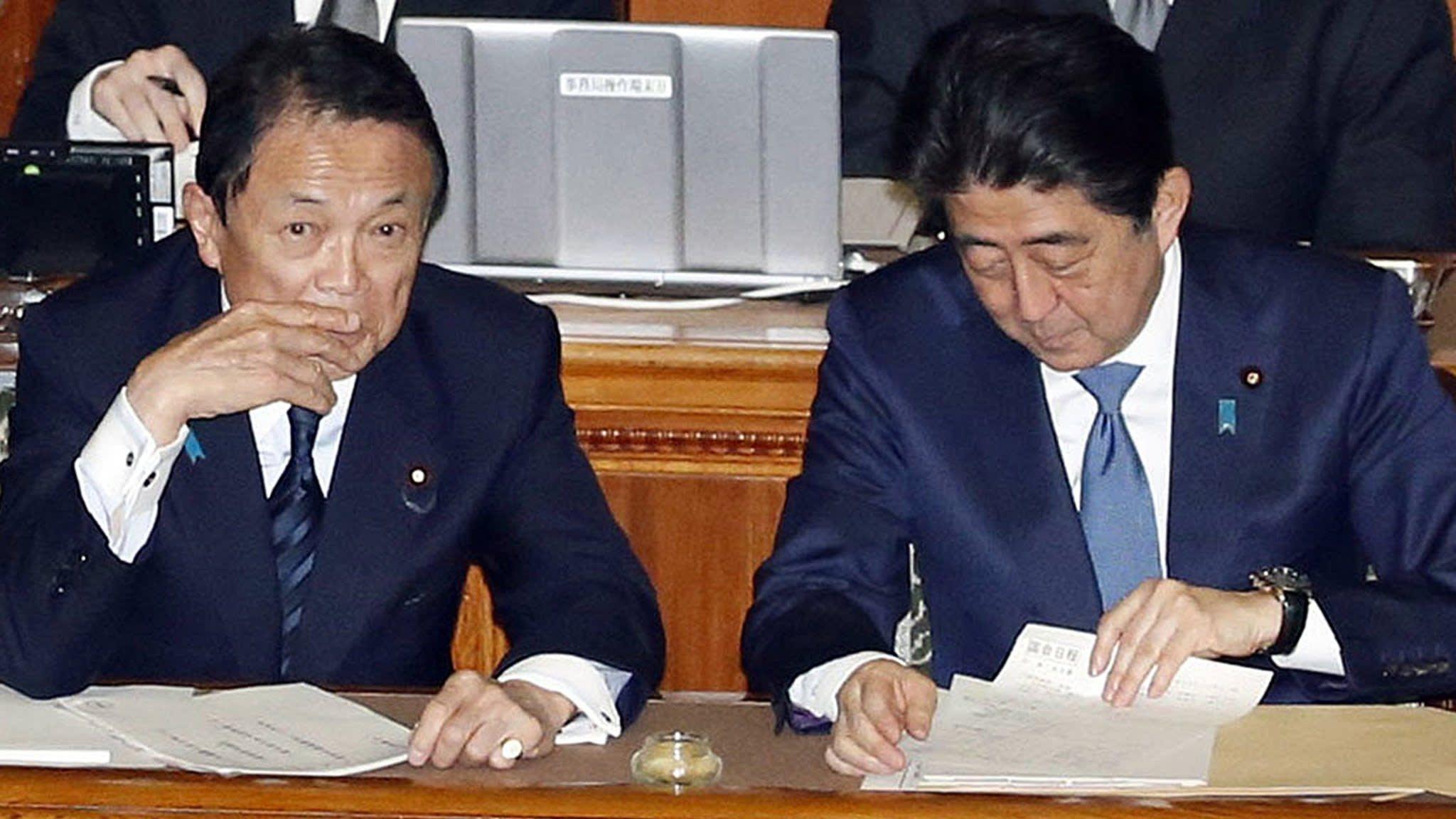 Scandal threatens Japan's finance minister Taro Aso