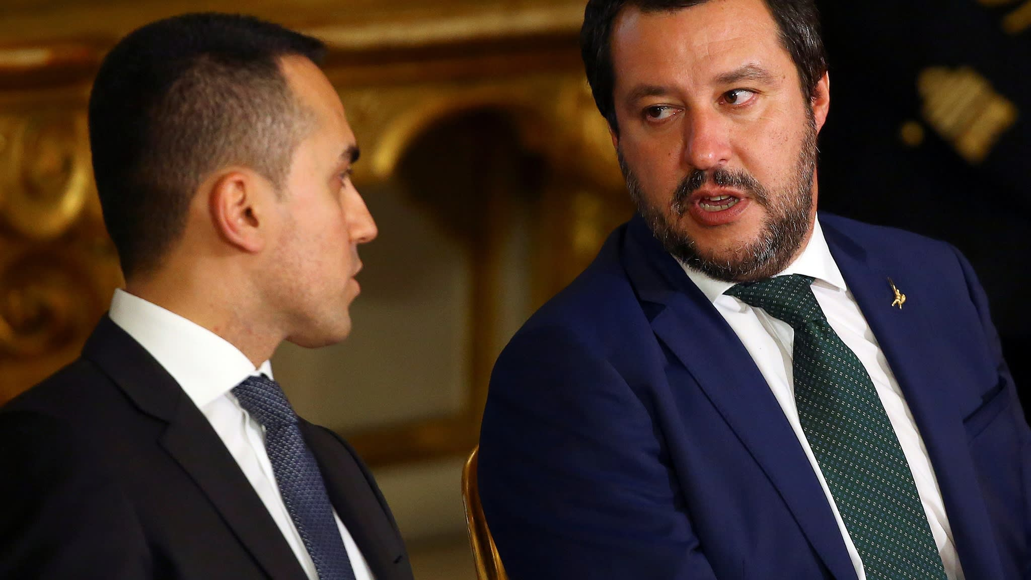Italy promises budget cuts to avoid EU sanctions