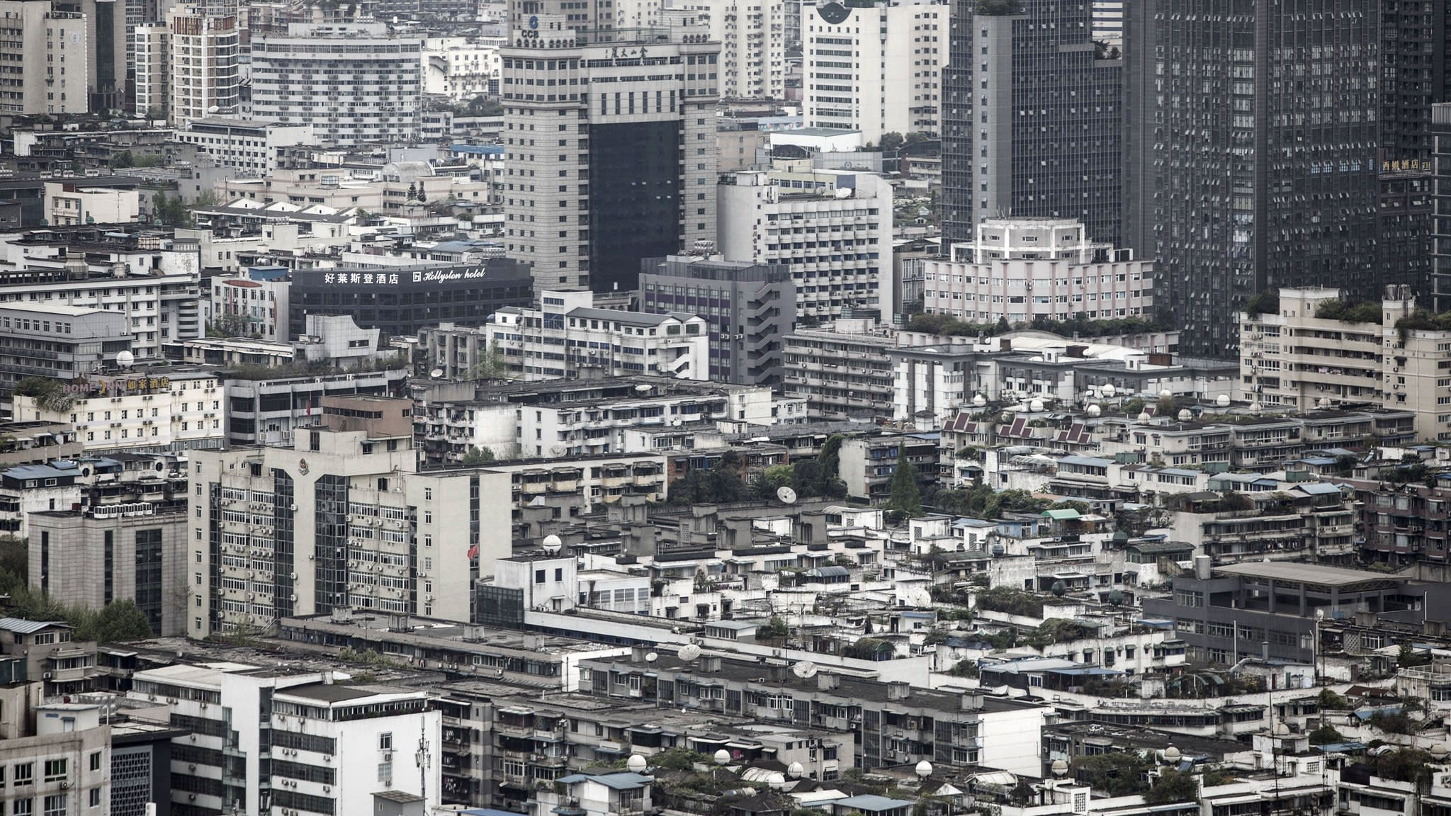 China revives long-stalled property tax to combat housing bubble