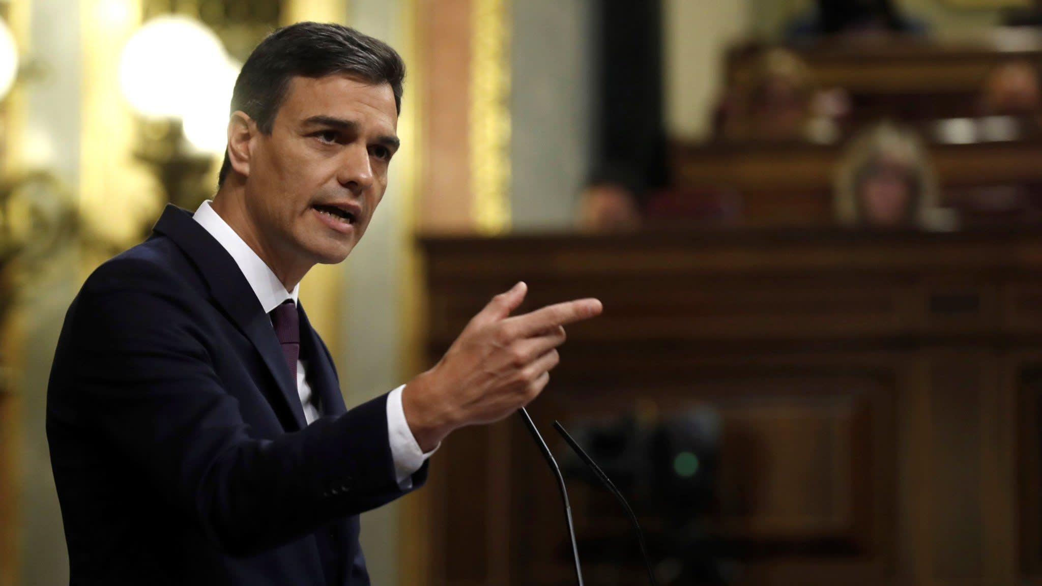 Spain's new prime minister vows to raise taxes and spend more