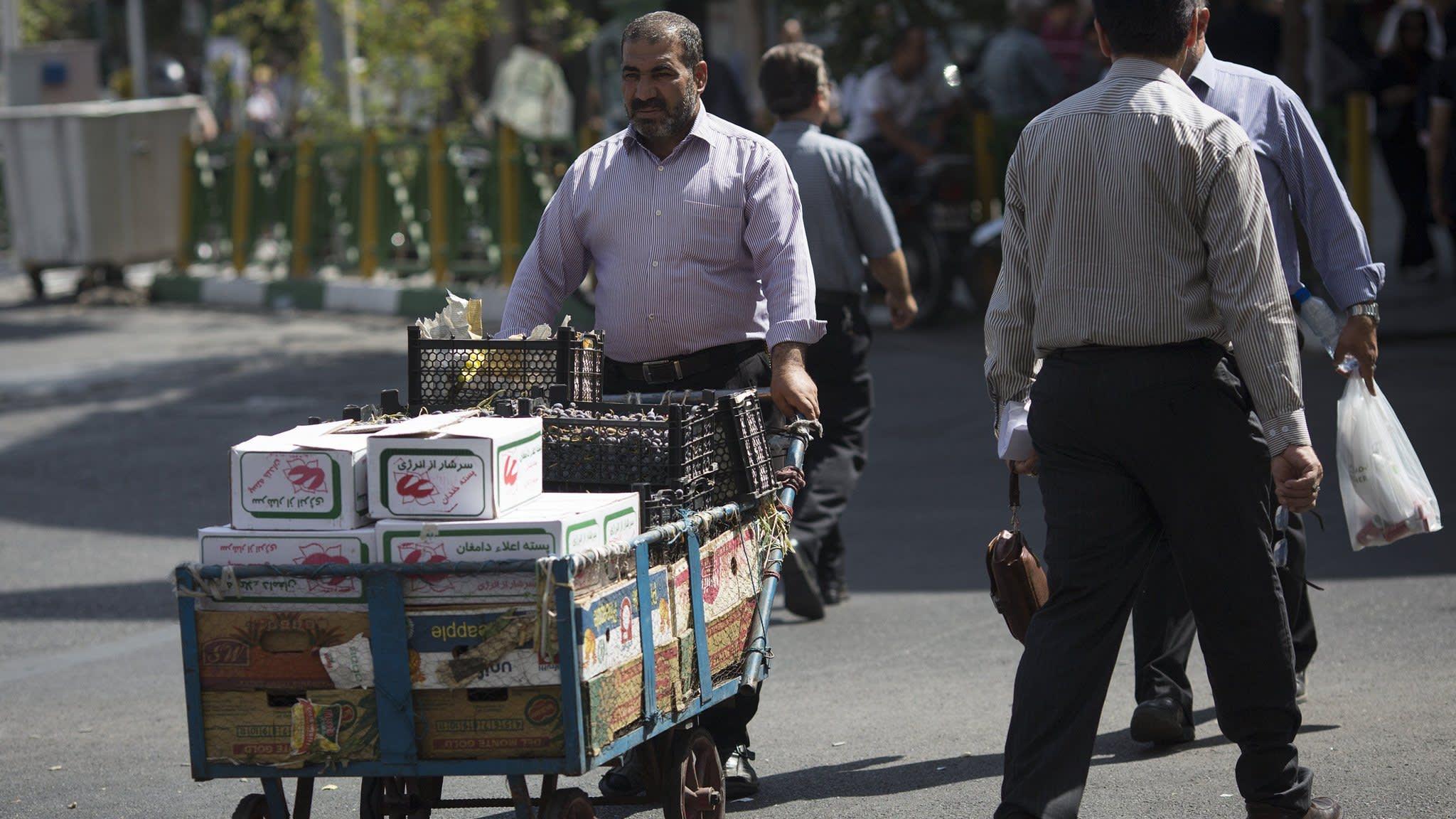 Iran's poor bear brunt of sanctions as food prices soar