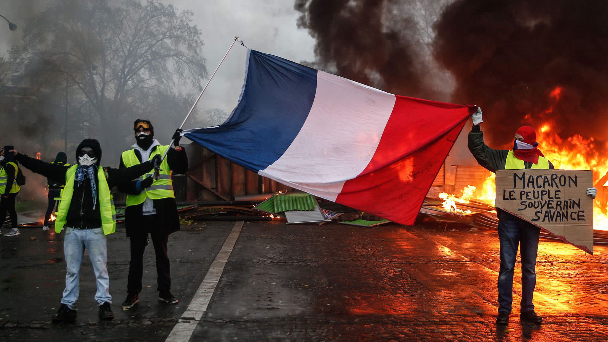 French government to suspend fuel tax rise after riots