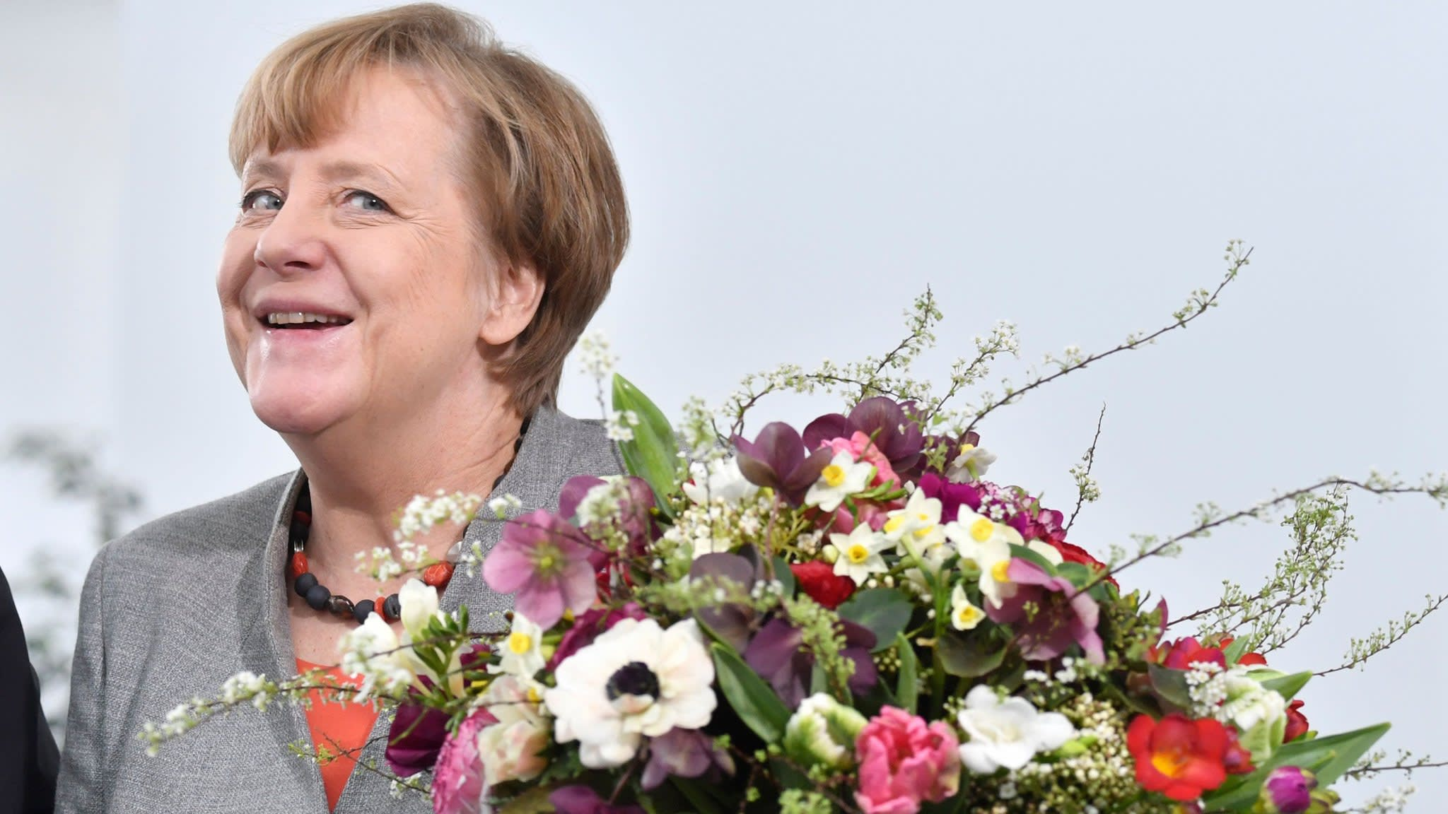 Deal with SPD puts Angela Merkel back in Germany's driving seat