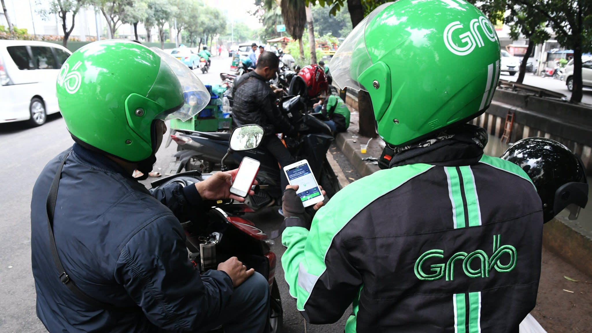 Uber nears deal with Grab to pull back in south-east Asia