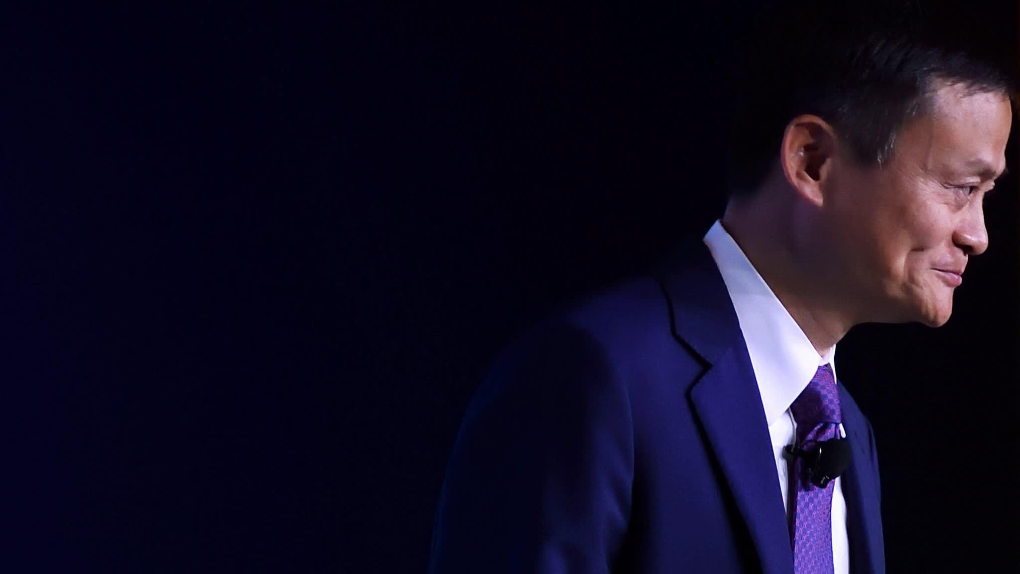 Alibaba cuts revenue forecasts as economic uncertainty bites