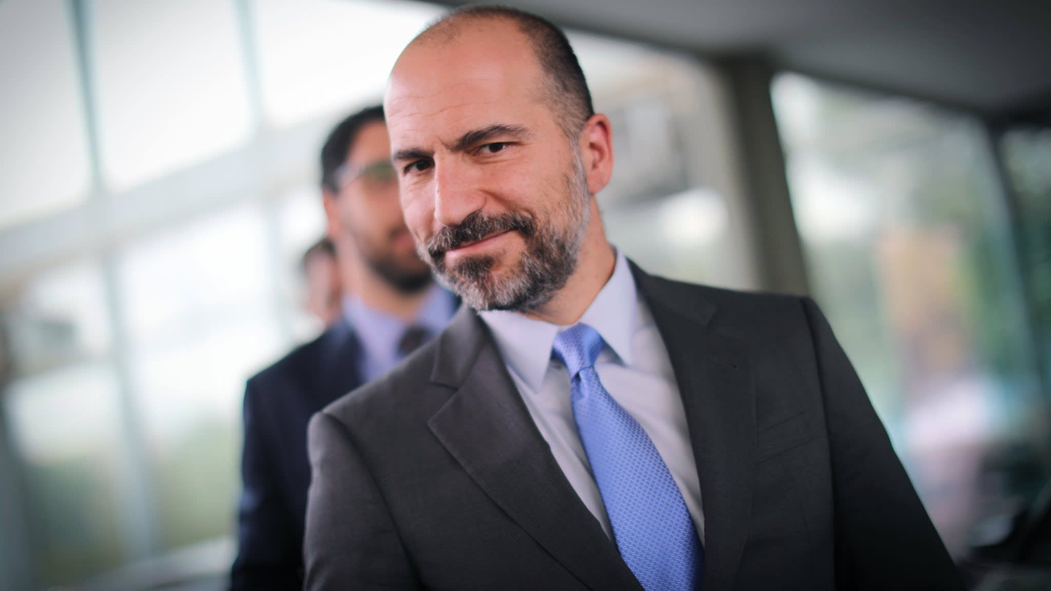 Uber pares quarterly losses and lifts revenues