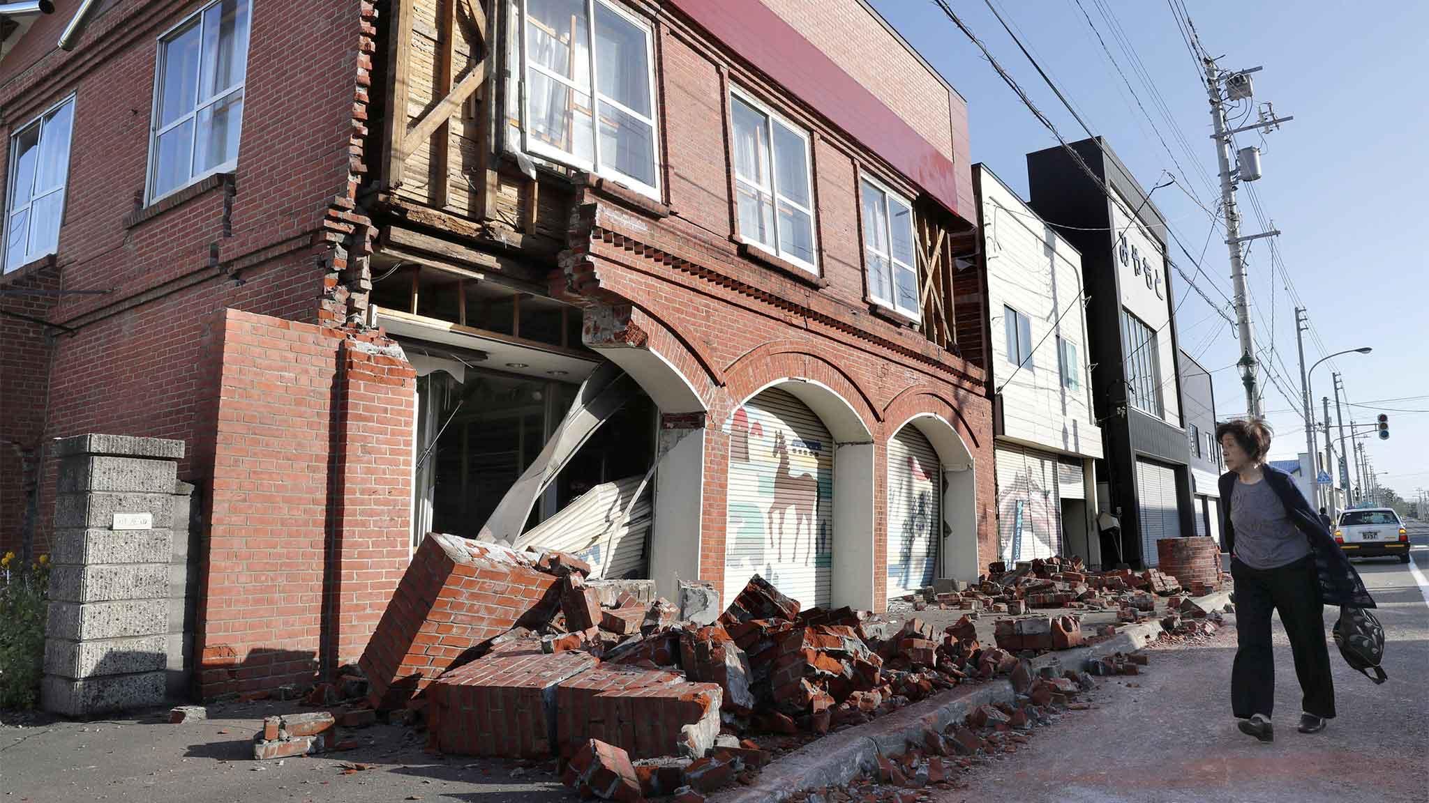 Japan earthquake buries homes and cuts power