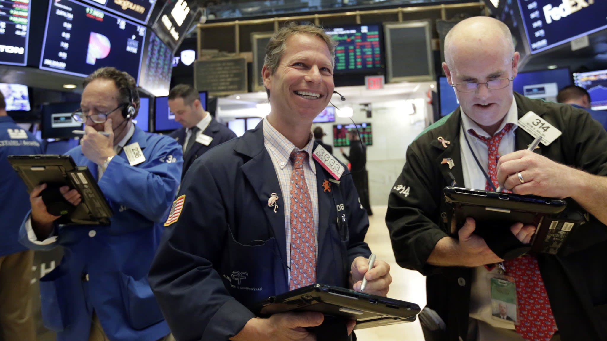 Wall Street hovers near record high
