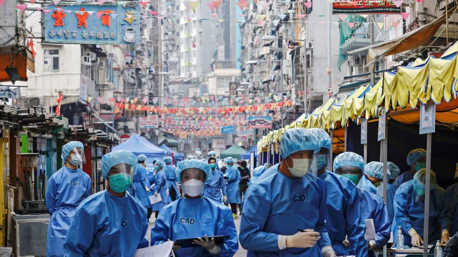 Coronavirus newest: Hong Kong chief praises 'ambush' lockdown that found only one case