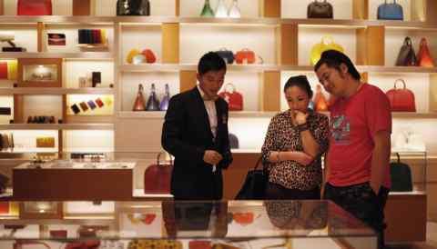 A couple shop at a Louis Vuitton store in Shanghai.