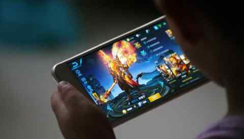 """A child plays the game """"Honor of Kings"""" by Tencent in Dezhou, China. The government is tightening control over the internet, a development that has the industry worried."""